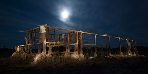 moon beams down on Bombay Beach